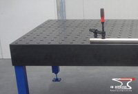 Welding table with holes